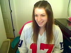 Dancing webcam girl strips off her football jersey and rubs her tight snatch