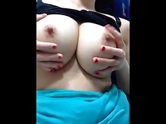 Big round Asian tits look perfect as she fondles them and sucks her hard nipples